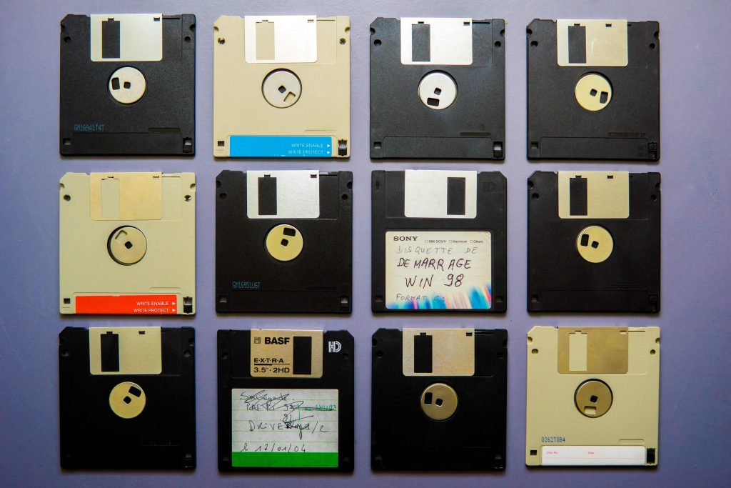 Old floppy discs arranged in a square.  Invest time and money into a website and own your data!