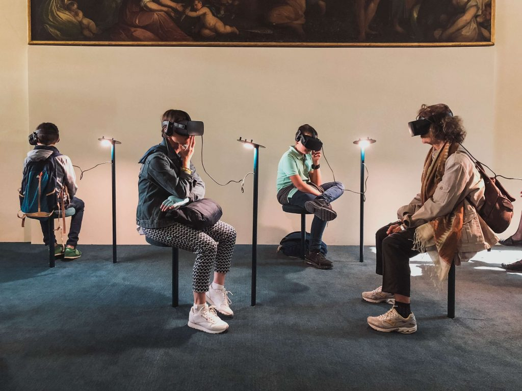 People using VR headsets in a museum. The future of technical content writing will heavily depend on new technologies and gadgets.